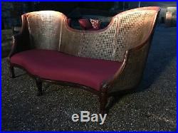 20 century rosewood double cane Bergere serpentine canope sofa