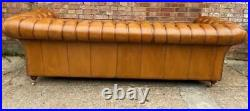 An Elegant Long Fully Buttoned Four Seater Tan leather Chesterfield Sofa
