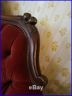 Antique Victorian style hand carved frame loveseat. Circa late 40's