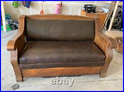 Antique Wood and Brown Leather Couch