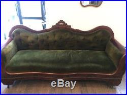 Victorian green velvet sofa